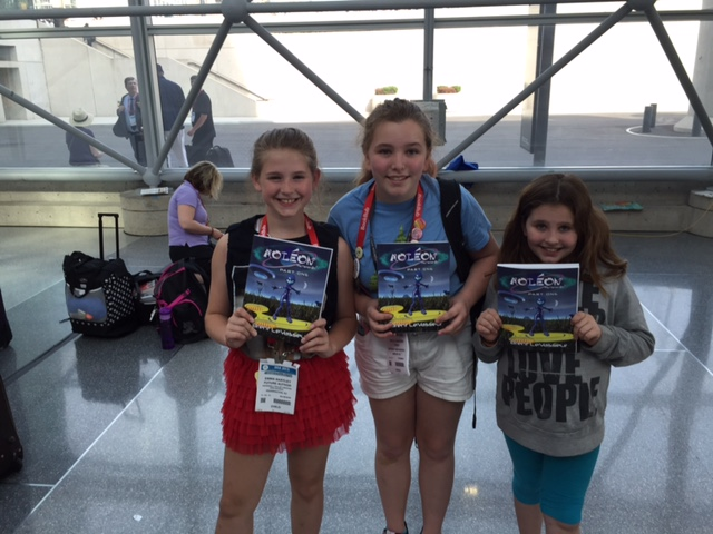 Kid fans holding autographed copies of Aoleon The Martian Girl Part 1 First Contact